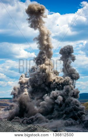 Explosive works on a coal mine open pit