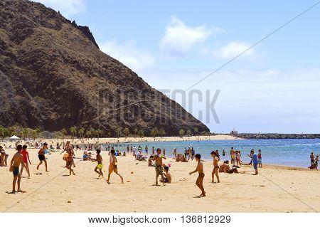 Playa De Las Teresitas beach Tenerife Canary Islands Spain Europe - June 14 2016: Children playing on the beach enjoying the sun