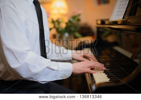 Close-up of a music performer's hands playing the piano