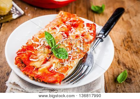 Homemade Cannelloni With Spinach And Tomato Sauce