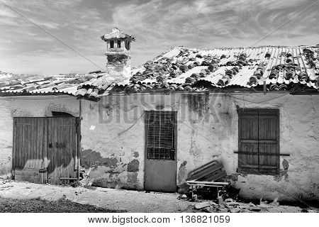 Black and white shot of a derelict house on Crete Greece