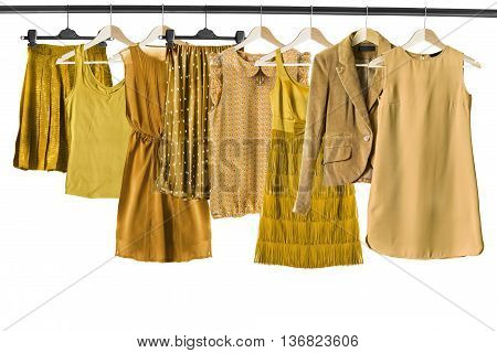 Set of yellow clothes on clothes racks isolated over white