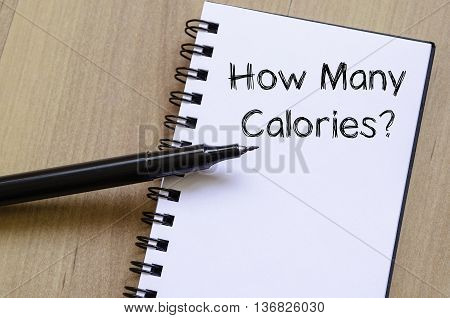 How many calories text concept write on notebook