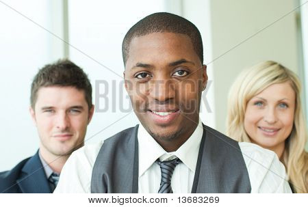 Portrait of an Afro-American businessman with his colleagues in folded arms
