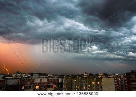Storm clouds, heavy rain. Thunderstorm and lightning over the city. Night Scene.
