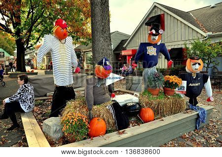 Intercourse Pennsylvania - October 13,  2015: Football themed Autumn decorations with pumpkins hay bales and Chrysanthemums at the Kitchen Kettle Village
