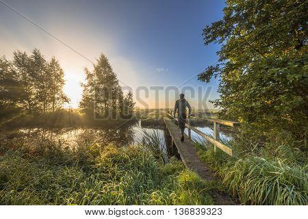 Person Crossing Bridge To The Bright Side