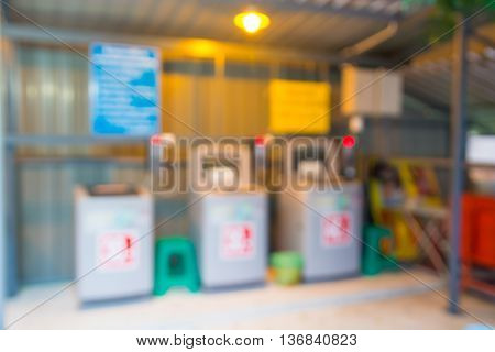 Blur Or Defocus Background Of Small Laundry Shop In Rural With Washing Machine