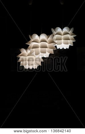 Designer ceiling lamp three pieces on a black background. White plafond