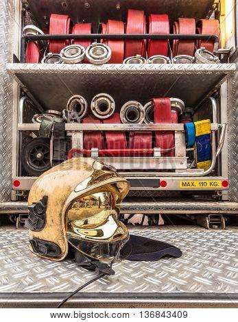 Modern Golden Fire Brigade Helmet With Hoses