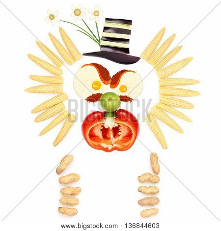 Angry clown made of vegetables and fruits in a kids menu isolated on white.