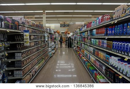 JOLIET, ILLINOIS / UNITED STATES - NOVEMBER 26, 2015: People shop for shampoo at the Jewel-Osco supermarket on Thanksgiving Day.