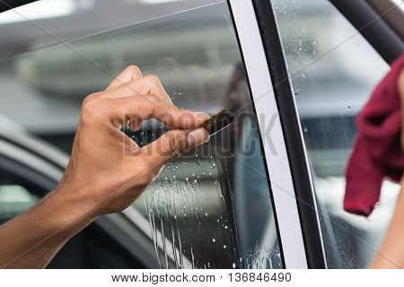 Car window tinting series : Scraping window surface