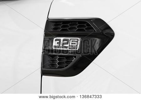 BANGKOK, THAILAND - JUNE 30, 2016 : 3.2 6 AUTO emblem on Ford Everest 2016 model, represents 3.2L TDCi Turbo Diesel engine install in latest SUV from Ford