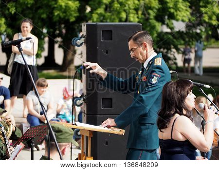 MOSCOW, RUSSIA - May 28, 2016: Band-master and singer during a performance on the Central Avenue in the Park of VDNH Moscow. International Military Music Festival