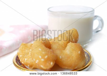Chinese cruller and soy milk on white background