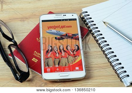 KOTA KINABALU, MALAYSIA - JULY 1, 2016: Vietjet Air on mobile app, the app helps managing travel plans, make bookings, check-in and choose seat anytime, anywhere.