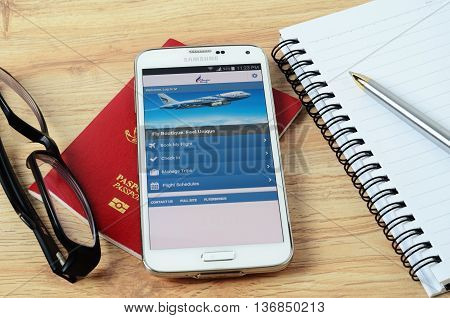 KOTA KINABALU MALAYSIA - JULY 1 2016: Bangkok Airways on mobile app the app helps managing travel plans make bookings check-in and choose seat anytime anywhere.