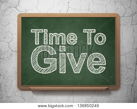 Time concept: text Time To Give on Green chalkboard on grunge wall background, 3D rendering
