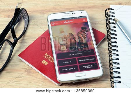 KOTA KINABALU MALAYSIA - JULY 1 2016: Airasia on mobile app the app helps managing travel plans make bookings check-in and choose seat anytime anywhere.