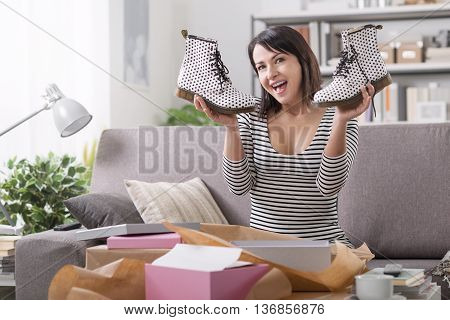 Cheerful Woman Opening A Parcel