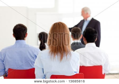 Senior manager giving a presentation in the office