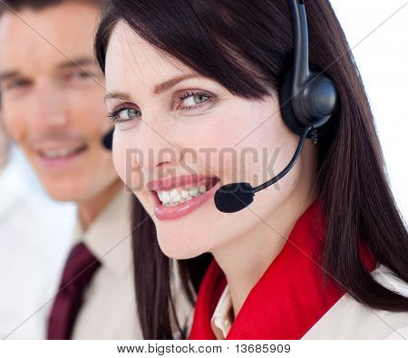 Portrait of a businesswoman with headset on smiling at the camera