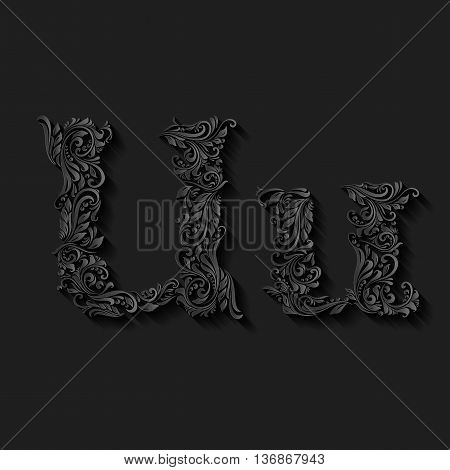 Handsomely decorated letter u in upper and lower case on black