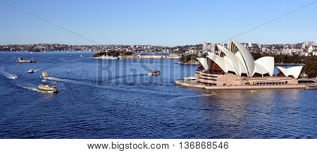 Sydney Australia - July 3 2016: many ships around Sydney Harbour and Sydney Opera House view from Harbour Bridge. The Sydney Opera House is identified as one of the 20th century's most distinctive buildings.