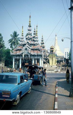 RANGOON / MYANMAR - CIRCA 1987:  Vehicles approach the Shwedagon Buddhist Pagoda in Rangoon.
