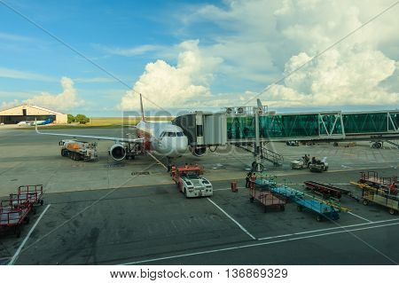 Kota Kinababalu, Sabah, Malaysia - June 16, 2016 : AirAsia Airplane stop for support service and transfer passenger, this picture was capture at airport waiting hall