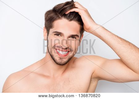 Portrait Of Happy  Healthy Man Combing His Hair With Fingers