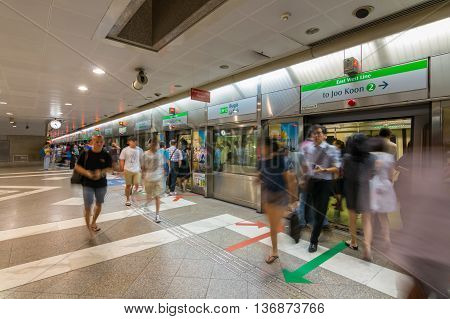 SINGAPORE - June 16,2016: Electric train station of Singapore Operations by Mass Rapid Transit Singapore (MRT) are going to east west line (Slightly in motion blur)