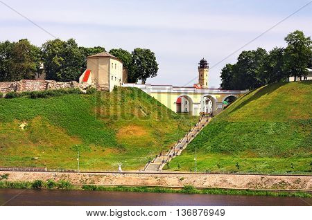 Remains of the ancient fortress old time bridge and the staircase on the top of the hill by the river
