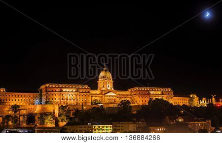 Buda Castle Moon Budapest Hungary. Buda Castle was first built in 1242 and enlarged by Empress Maria Theresa in the 1700s.