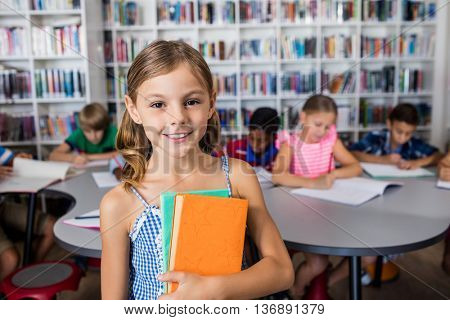 A little girl standing in the library