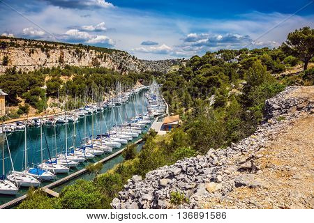 Calanque National Park - small fjords between Marseille and Cassis. White sailboats moored in rows near the shore
