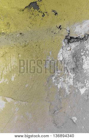 Background of peeling and damp wall; actual damage caused by moisture.