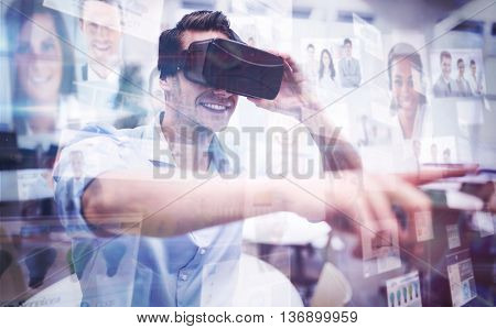 Business people against man using a virtual reality device