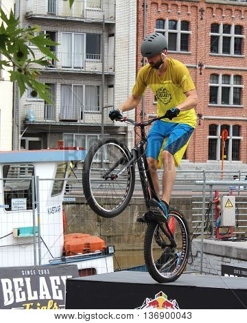 AALST, BELGIUM, 3 JULY 2016: Profesional trialbiker Andy Masschelin demonstrates his skills at the annual sport market in Aalst. He is a member of the well known Belaey Trials Team.