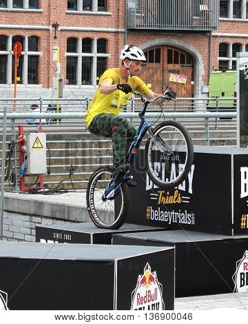 AALST, BELGIUM, 3 JULY 2016: Profesional trialbiker Wesley Belaey demonstrates his skills at the annual sport market in Aalst. He is a member of the well known Belaey Trials Team.