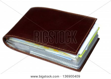 The brown leather card holder isolated on a white background.