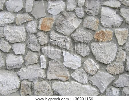 The wall of natural stone as background