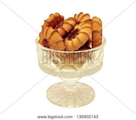Tasty biscuits with a filling of jam in a crystal vase on a white background.