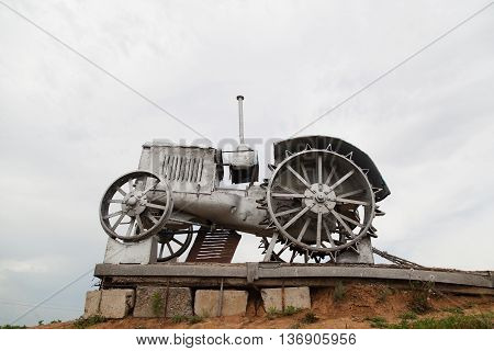 VOLGOGRAD RUSSIA - June 19 2016: The retro monument a tractor - to the first plowmen of the earth tatsinsky is devoted. Rostov region. Highway M21 Rostov region Russia