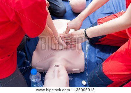 First aid training. Cardiopulmonary resuscitation - CPR. Chest compression. Cardiac massage.