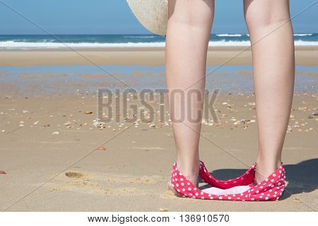 Back View Of A Woman At The Beach Holding With Bikini