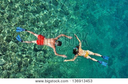 Romantic couple snorkeling in the sea in honeymoon