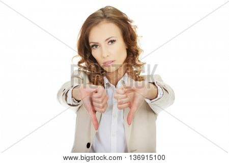 Businesswoman with thumbs down gesture.