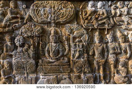Bas-relief in Borobudur Buddist Temple - island Java Indonesia - architecture background